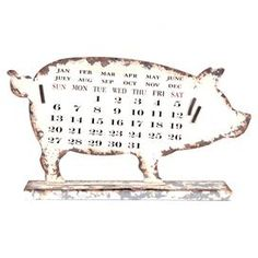 Pig-shaped magnetic calendar.   Product: Pig d�corConstruction Material: MetalColor: Natural and whiteDimensions: 10 H x 19 W