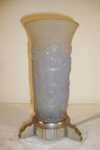 A rare art deco table lamp by Costabelle, the strongly opalescent glass designed with stylised figures and mounted onto a good quality nickelled-bronze base. France c1925.