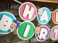 Bubble Guppies Birthday Banner!   The circles are made with a white cardstock background, alternating colorful foreground, and white wording that says HAPPY BIRTHDAY. There are 6 printed characters decorating the letters. Everything is attached with foam squares to give it dimension. These are strung on a white satin ribbon with plenty extra to hang the banner. Circles are approximately 5. Please let me know if you would like different colors or wording on your banner.