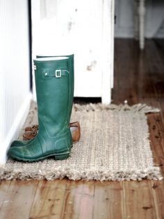 The link is about how to clean hardwood floors, but I like the idea of using a rug for boots rather than a tray.