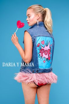 "Denim vest ""POP"" of dark blue color. Hand painted in Pop Art style, decorated with detachable ostrich feathers high quality of dark pink colour and rhinestones."