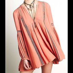 FREE PEOPLE JUST THE TWO OF US TUNIC FREE PEOPLE JUST THE TWO OF US TUNIC/TOP. Oversized swingy fit. Lace inserts. V front. Balloon sleeves. Gorgeous salmon colour. No trades. Free People Dresses