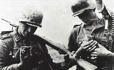 Two german soldiers rescued a couple of small kittens (WWII).
