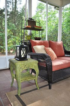 Screened porch ideas- I like the lantern decor
