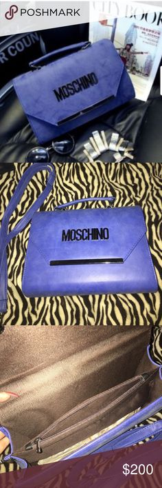 """Moschino suede blue clutch crossbody bag purse Moschino cobalt blue bag. Gunmetal colored hardware with """"Moschino"""" on front. Brown color inside. Can be carried as a clutch or it comes with detachable  straps if you want to carry over the shoulder or as a crossbody. Approx measurements: length from top of bag to bottom almost 8"""", width across almost 11"""". **I do not try on items so please do not ask**  NEW never worn no flaws . <Price reflects auth> Moschino Bags Clutches & Wristlets"""