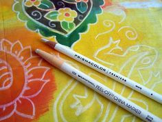 Using a white Berol Prismacolor pencil (more waxy, creamy and resistant) and a China marker on fabric with acrylic ink. Pencil for thin lines, China marker for thicker lines. Great post by Judy Coates Perez: How Can You Resist Such a Simple Technique?