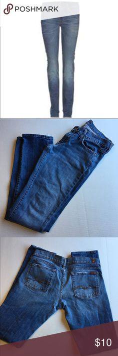 Roxane 7 For All Mankind Jeans Medium wash 7 for all Mankind jeans are low rise and boot cut. The have a slight rip under booty cheek. 7 For All Mankind Jeans Boot Cut