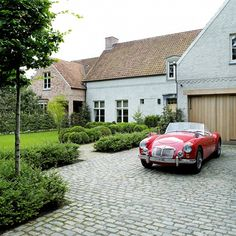 Beautiful simple Belgian New- built house. Car is not Bad, either!