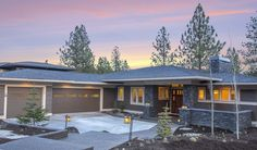 Prairie style architecture with 3 car garage Greg Welch Construction Bend, OR