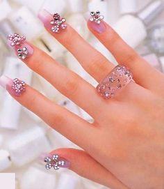 Flower gemstone nail design in light pink :)