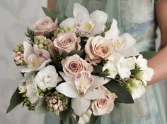 Hyacinths, freesias, cymbidium orchids and roses combined with rosemary and eucalyptus.