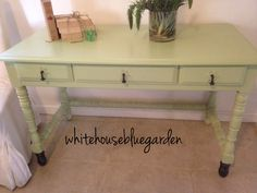 Sweet minty desk with drop pulls and stained feet