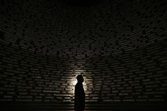 A worker looks at names of the 2004 tsunami victims on a wall at the Aceh Tsunami Museum during preparations for a ceremony in Banda Aceh December 25, 2014. On December 26, 2004, a magnitude 9.15 quake off the coast of Indonesia's Aceh province triggered an Indian Ocean tsunami that killed around 226,000 people in Indonesia, Sri Lanka, India, Thailand and nine other countries. (REUTERS/Beawiharta)