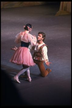 """New York City Ballet production of """"Coppelia""""; scene from Act 1 with Patricia McBride as Swanilda and Mikhail Baryshnikov as Franz, choreography by George Balanchine and Alexandra Danilova after Marius Petipa (Saratoga)"""