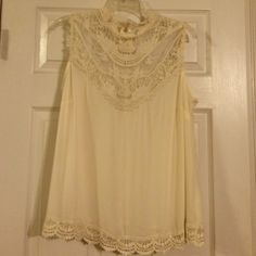 Forever 21 blouse Beautiful lace with small mock turtleneck. Roomy and sheer. I wore Cami underneath it with tights. Only worn once. Excellent condition. I love this piece but cream just isn't my color. Forever 21 Tops Blouses