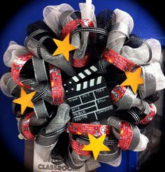 I love this, maybe for my wall....  Movie Themed Wreath by CharlaGriffinDesigns on Etsy, $50.00