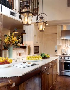Warm + Cozy Kitchen. I love the idea of the lamps above the center island
