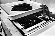 William Eugene Smith used two trays, one above the other, as a print washer.        Freshly fixed prints are placed in the bottom tray, which rinses with overflow from the top tray.        After partial washing, the final wash was given in the top tray.        The water entered and left the top tray by way of the Kodak siphon attached.        The lower tray overflowed into the sink.