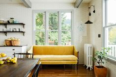Yellow couch, midcentury modern, vintage lamp, window