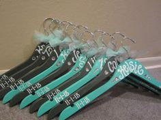 custom painted wood hangers for weddings, bridesmaids gifts, and bachelorette party
