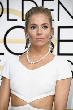 Actress Sienna Miller attends the 74th Annual Golden Globe Awards.