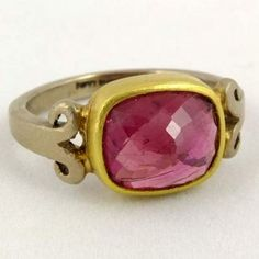 POPPY DANDIYA  - Pink tourmaline set in 18k yellow gold with with 18k white gold band. The tourmaline measures 10mm x 8mm approximately.