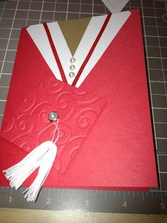 handmade graduation card ... cap and gown style .. red and white ... tassel  on mortar board ...