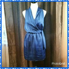 Royal blue silky dress. Like new. Beautiful silky sleeveless dress. Gathered at the waist.  Ties on the side. 100% polyester.  36.5 inches from shoulder to hem. Perfect for a wedding, date night or a night out with the girls. The Limited Dresses Midi