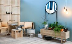 chair with wrap; credenza with space on top for books or plants; that mirror; those lights...