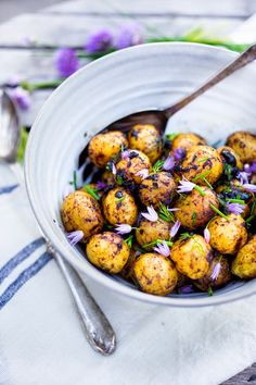Grilled baby potato salad with Black garlic vinaigrette, dill and chive blossoms | www.feastingathome.com