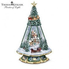 Thomas Kinkade gifts make beautiful Christmas presents and decor. This Christmas tree is just one of many choices. Tabletop Christmas Tree, Christmas Decorations, Christmas Presents, Thomas Kinkade Christmas, Disney Snowglobes, Art Thomas, Christmas Snow Globes, Disney Ornaments, Beautiful Christmas