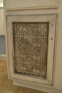 Use decorative tin tiles to resurface cabinet doors tutorial.