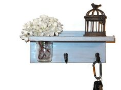 """Small Distressed Shelf with 2 Key hooks and removable Mason Jar Vase for easy cleaning. This shelf measures Approx. 13"""" W x 5 ½"""" H x 6"""" D and fits well next to your entry door!"""