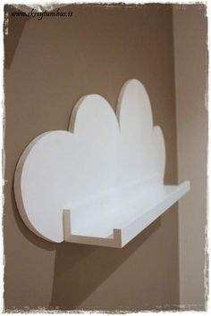 Cloud shelf, made with Ribba picture ledge and cloud backdrop painted white.