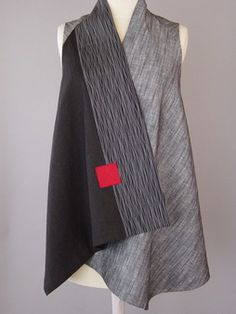 Wrapped Shoulder Vest in Mottled Gray and Black Linen and rayon cloth is stitched to silk with an accent area of voile overlay with close wavy stitching.