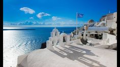 The iconic blue and white colors of Santorini~