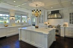 Traditional Kitchen with Crown molding, L-shaped, Kitchen island, Wall sconce, Chandelier, Subway Tile, Custom hood
