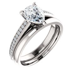 pear shape engagment ring #www.nzjewellers.co.nz #wwww.nzdiamonds.co.nz #hand made engagment rings #g.i.a #pear shape #halo engagment rings