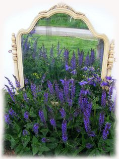 Vintage Dresser mirror used in the garden. Note-mirrors should never be placed so that sunlight can reflect through mirror-poses fire hazard. This one is placed under an overhang, so that no sunlight can get to it.