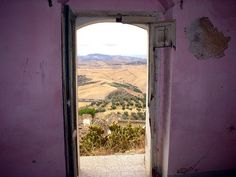 Craco-window - abandoned medieval village located in the region of Basilicata, about 25 miles inland from the instep of the boot of Italy.
