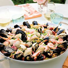 Grilled Seafood and Chorizo Paella with Allioli by Sunset Magazine. When you really want to impress your guests, pull out this amazing paella dinner. Fish Recipes, Seafood Recipes, Great Recipes, Favorite Recipes, Mussel Recipes, Yummy Recipes, Yummy Food, Grilled Seafood, Fish And Seafood