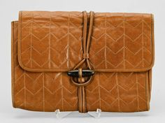 brown leather YSL clutch