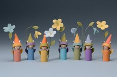 "Make this family of summer flower children. ""Making Peg Dolls"" book by Margaret Bloom will show you how!"