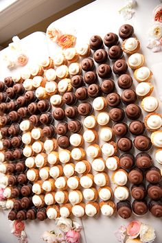 Getting creative with your dessert display is an easy way to elicit a wow factor. Serving cupcakes? Instead of placing them in traditional tier, arrange them in the initial of your new last name.