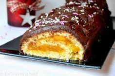 Υπέροχος Χριστουγεννιάτικος κορμός πορτοκαλιού με γλάσο σοκολάτας. Μια συνταγή για ένα πεντανόστιμοκορμό που σίγουρα θα απολαύσετε με την οικογένειά σας κ