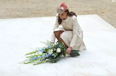 Catherine, Duchess of Cambridge lays a floral tribute at St Symphorien Military Cemetery on August 4, 2014 in Belgium.