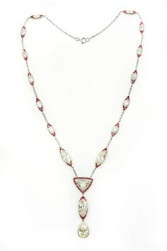 20th century diamond and ruby pendant necklace, c.1905   , the fine link platinum chain with graduated navette shaped diamond and ruby spacers, to a trilliant-cut diamond with ruby line surround suspending a further navette shaped spacer and final pear-cut diamond drop, open set in platinum and gold   Length 54.4cm / 21 1/2''