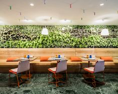 estudiHac's cheese bar for hotel melia features a vertical garden