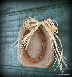 horse shoe  would be good to put beside the stall door with the horses name.. :)