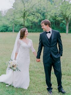 David's Bridal bride Kaylie in a 3/4 sleeve allover lace trumpet wedding dress from David's Bridal Collection (style WG3684)
